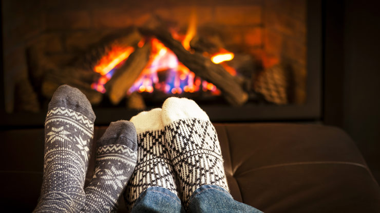 Warm feet by fireplace