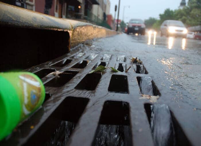 close view of catch basin in the rain