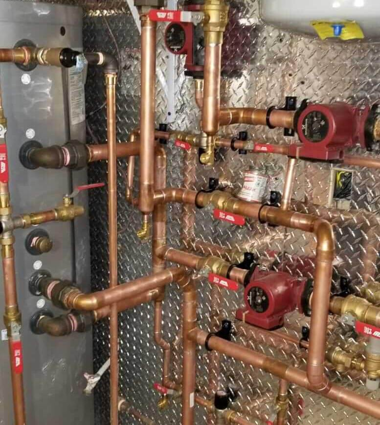 many uninsulated copper pipes