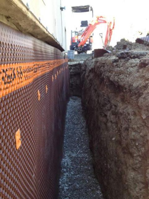 delta-ms-on-exterior-basement-wall