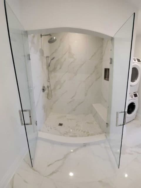 residential-plumbing-two-door-shower-clogged