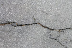 asphalt cracks due to water damage