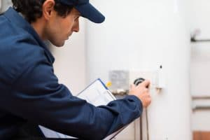 technician turning off water heater