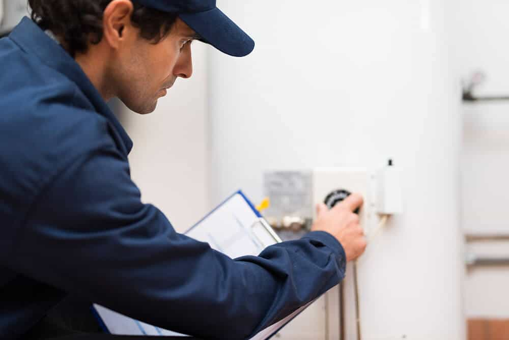 technician turning off water heater