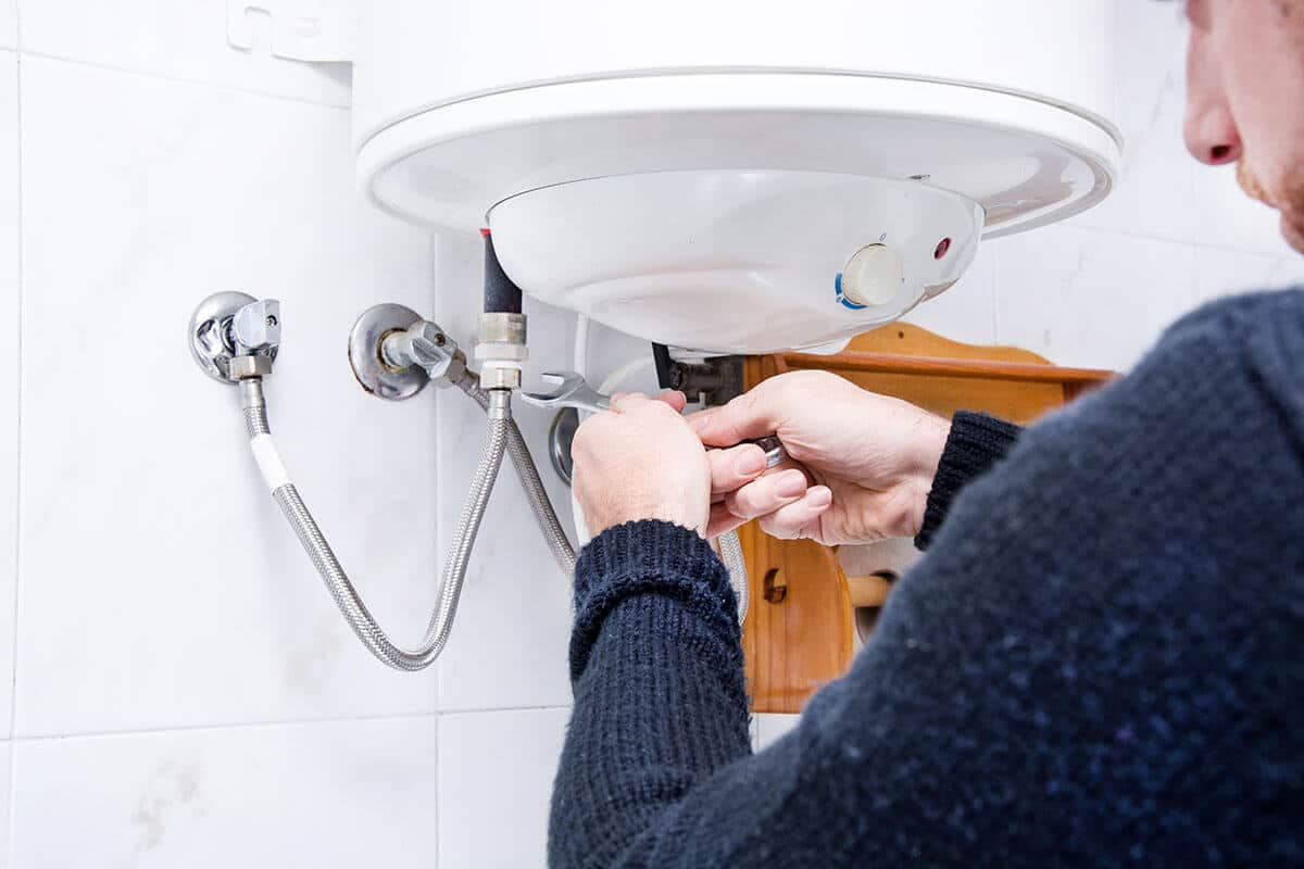 plumbing installing an electric water heater