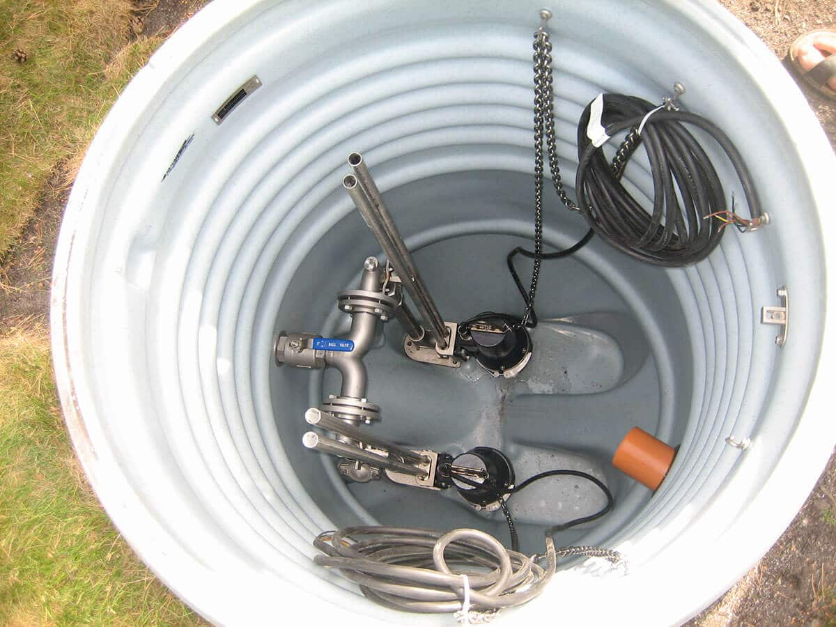 sump pump being cleaned